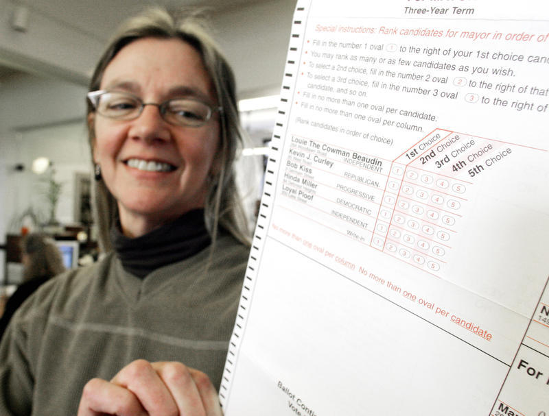 Jo LaMarche, the city election director of Burlington, Vt., holds a runoff election ballot for the mayor's race Thursday, March 2, 2006.