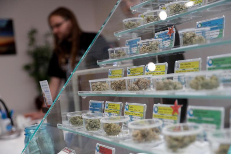 Various strains of marijuana are displayed at the KindPeoples dispensary in Santa Cruz, Calif., in December.