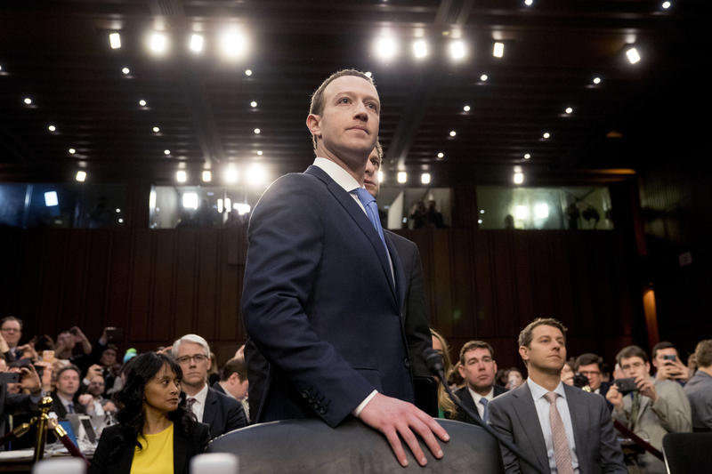 Facebook CEO Mark Zuckerberg arrives to testify before a joint hearing of the Commerce and Judiciary Committees on Capitol Hill in Washington, Tuesday, April 10, 2018, about the use of Facebook data to target American voters in the 2016 election.