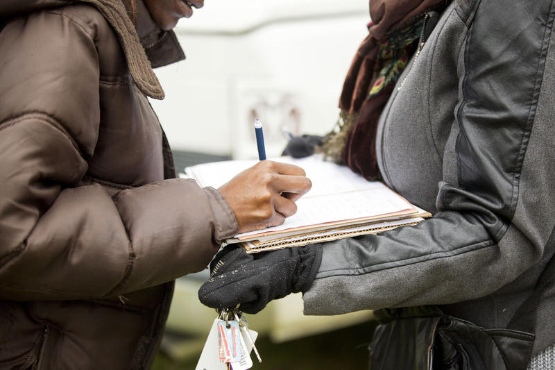Nanette Edgeston-Green (right) gathers signatures on a petition to restore lawmakers' term limits before the Martin Luther King Jr. Day parade in Little Rock, Ark., in Jan. 2016.