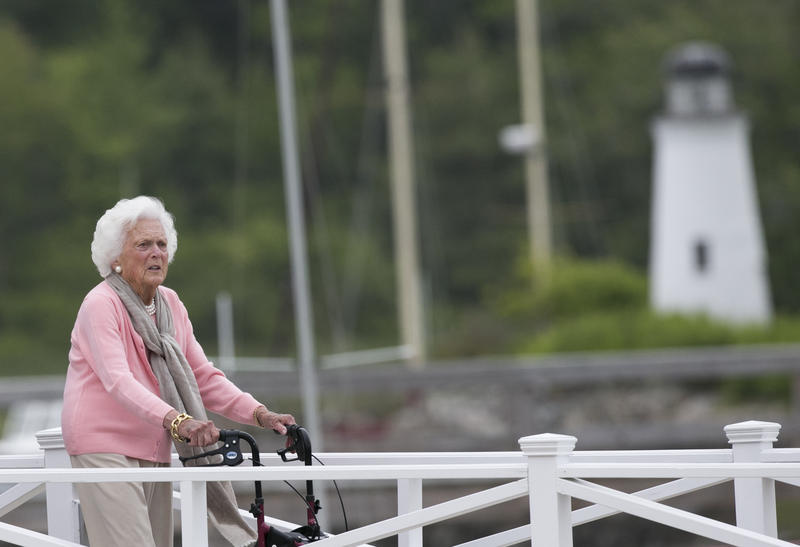 Former first lady Barbara Bush uses a walker as she leaves a luncheon at the Kennebunk River Club on her 90th birthday, Monday, June 8, 2015, in Kennebunkport, Maine.