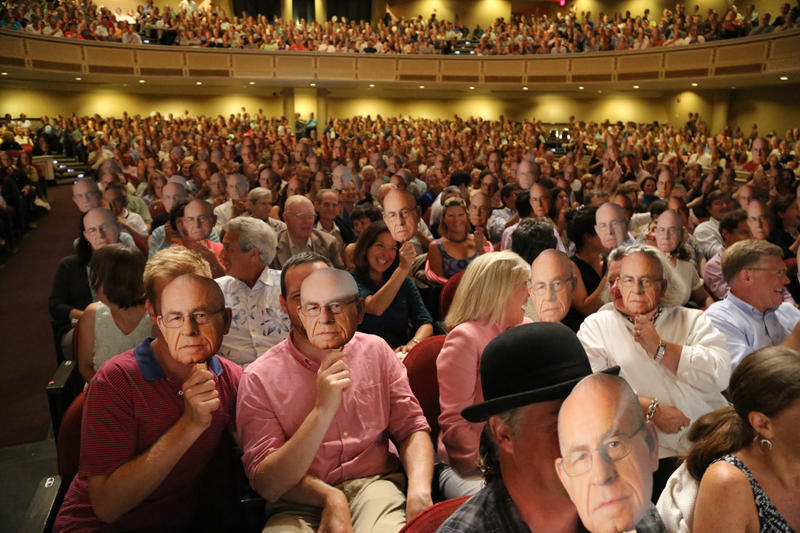 A sold-out Merrill Auditorium crowd was provided Carl Kasell masks in 2012.