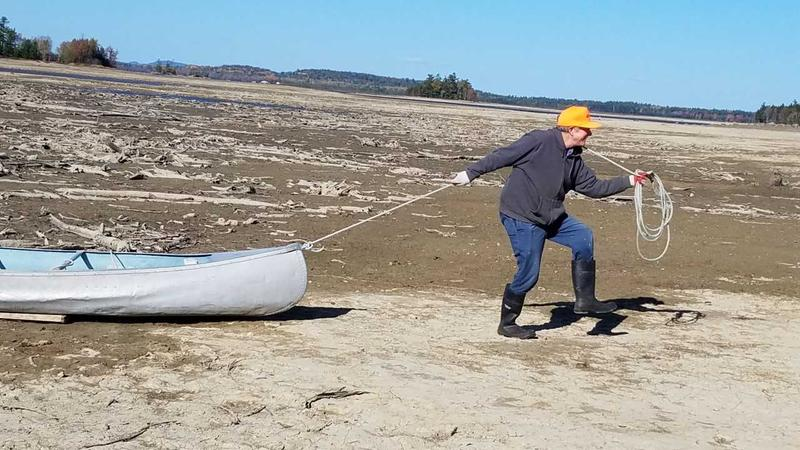 Graham Lake property owner Ed Damm had to drag his canoe more than 200 yards across a dry lake bed after Brookfield Energy's release of water at the Graham Lake Dam last year.
