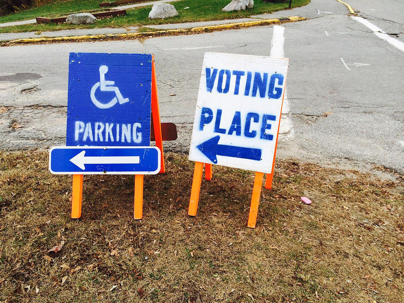 Signs directing voters outside a Maine polling place, seen Nov. 4, 2014.