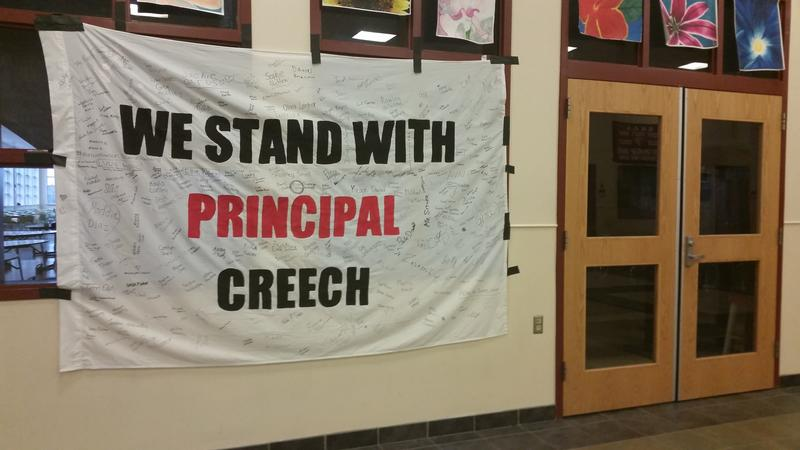 A banner at Scarborough High School signed by students, supporting Principal David Creech.
