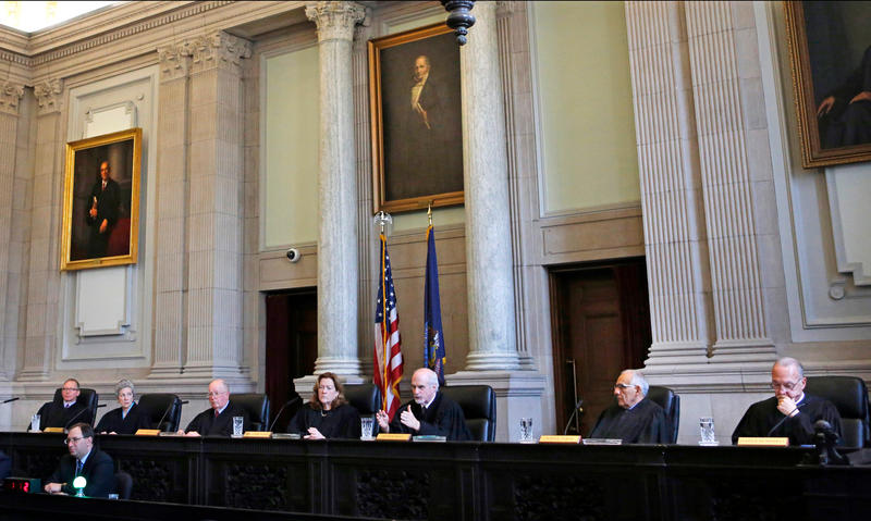In this Thursday, April 12, 2018, photo, Maine Supreme Court justices hear testimony on whether ranked-choice voting can be used in Maine's June 12th primary, in Portland, Maine.