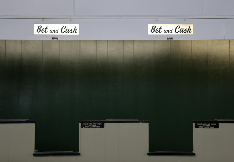 Betting windows are seen at Monmouth Park Racetrack in Oceanport, N.J., Monday, May 14, 2018. The Supreme Court on Monday gave its go-ahead for states to allow gambling on sports across the nation, striking down a federal law that barred sports betting.