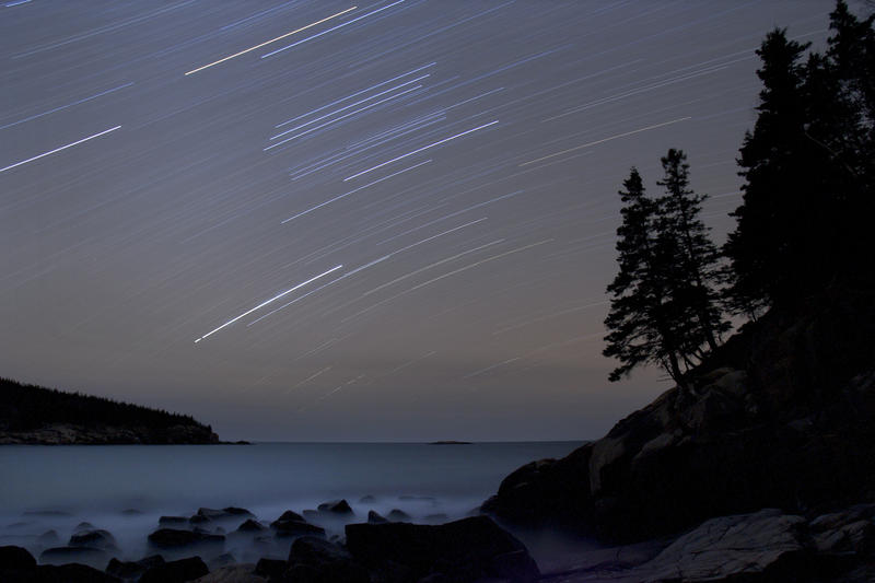 In this file photo made Dec 20, 2006, stars trails streak across the sky in a 75-minute time-exposure at Acadia National Park, Maine.