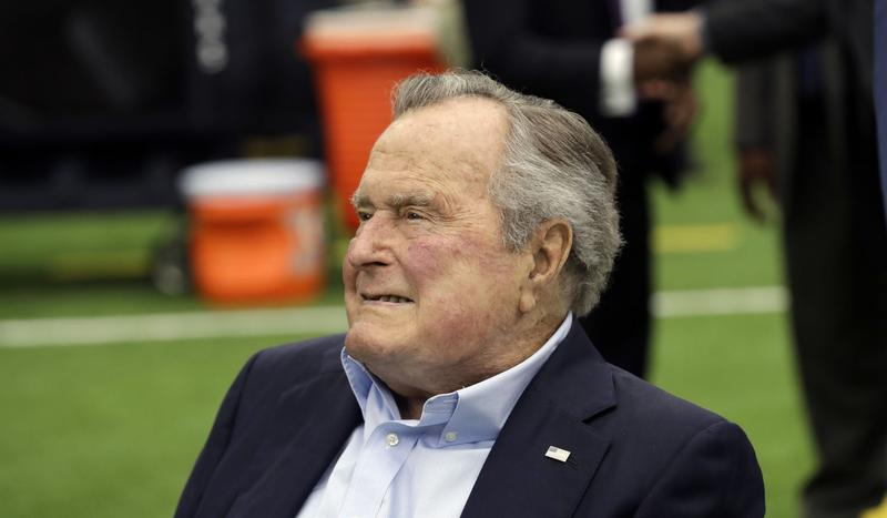 FILE- In this Nov. 5, 2017, file photo, former president George H.W. Bush arrives for an NFL football game between the Houston Texans and the Indianapolis Colts in Houston.