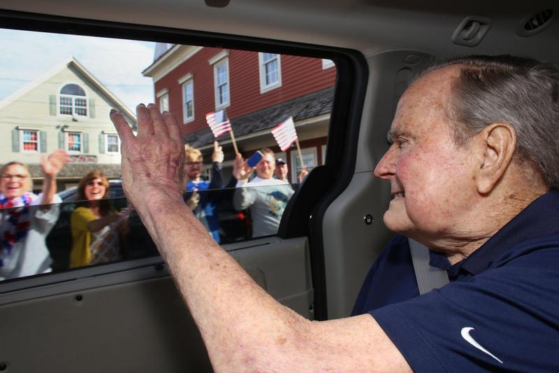 Former President George H.W. Bush waves to the crowd in Kennebunkport as he returns to Maine for the summer.