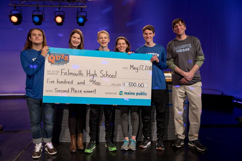 The Falmouth High School team holds its $500 check for their school's Project Graduation after finishing second in season two of High School Quiz Show Maine.