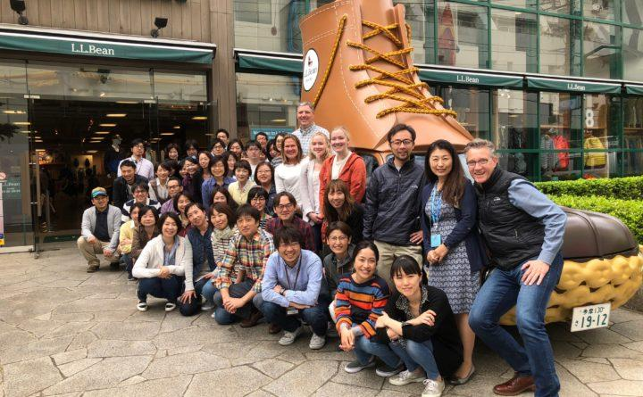 Zane Shatzer (front), managing director of Japan and Asia Pacific for L.L.Bean International, with his marketing team and the Japanese L.L.Bean Bootmobile, in the Kichijoji section of Tokyo, where the L.L.Bean Japan branch office is headquartered.