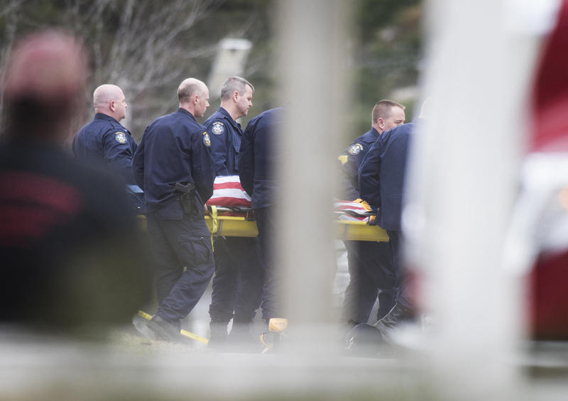 The body of Somerset County Sheriff's Deputy Eugene Cole is brought out and loaded into a medical examiner's van on Wednesday, April 25, 2018.