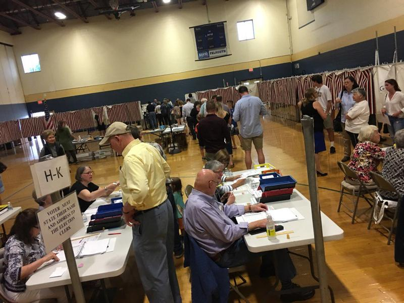 Voters lined up at the Falmouth polls at about 6:30 p.m. on Tuesday.