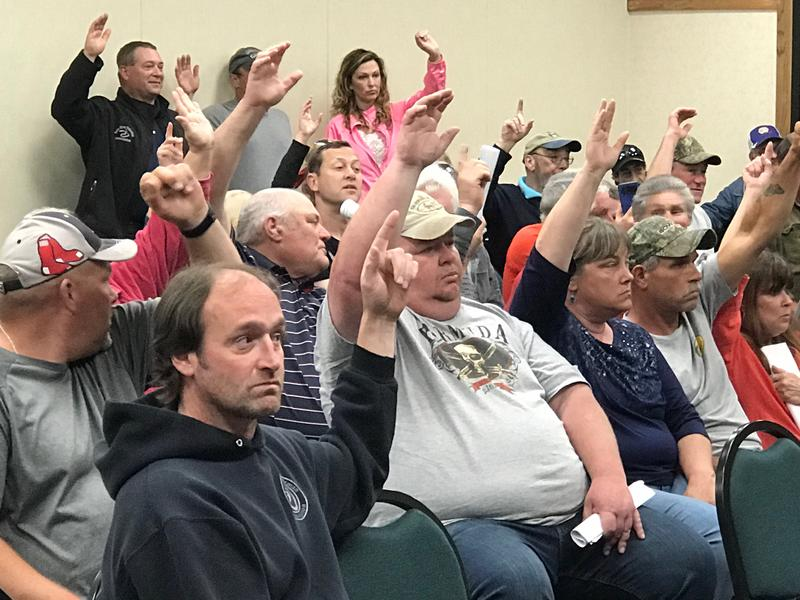 Fishermen attending a Brewer hearing on elver quotas unanimously signal their support for increasing catch limits with a show of hands.