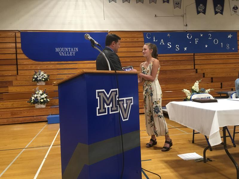 Mountain Valley High School math teacher Jeffrey Pelletier presents senior Brooke Carver with a math award at the school's senior banquet.