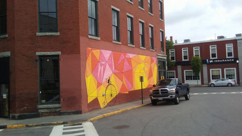 On the side of Elements coffee shop on Main St. in Biddeford