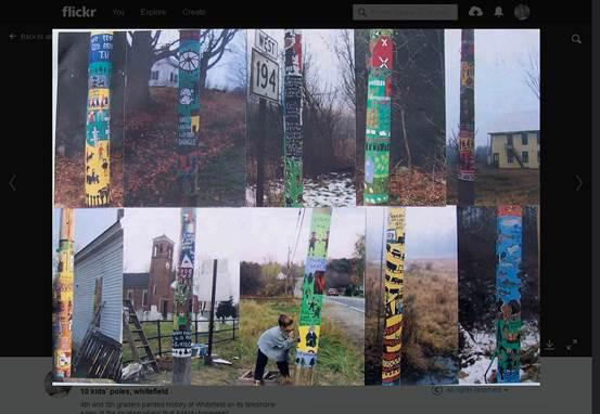 Some of the utility poles painted by Natasha Mayers in Whitefield, Maine.