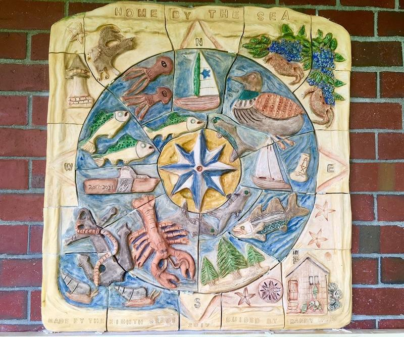 Artist in residence Randy Fein led 20 8th grade students and their art teacher Julie Ryan to create the clay mural: Home by the Sea