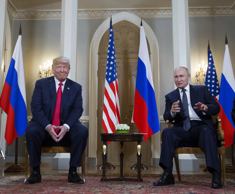 Russian President Vladimir Putin, right, makes a statement as U.S. President Donald Trump, left, looks on at the beginning of a meeting at the Presidential Palace in Helsinki, Finland, Monday, July 16, 2018.