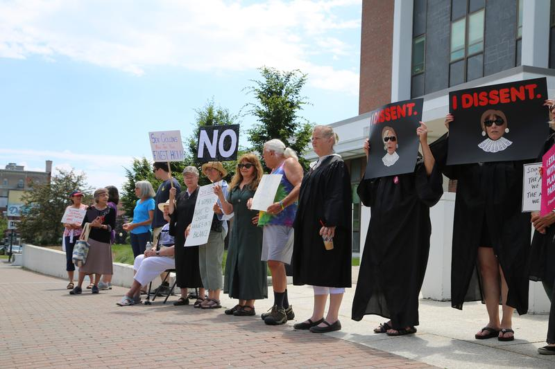 About twenty people spent their lunch break in downtown Bangor Tuesday protesting President Trump's nomination of Judge Brett Kavanaugh to the Supreme Court.