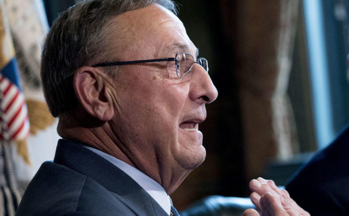 Gov. Paul LePage speaks with reporters before a meeting to discuss health care and tax reform in the Eisenhower Executive Office Building in Washington on Sept. 22, 2017.