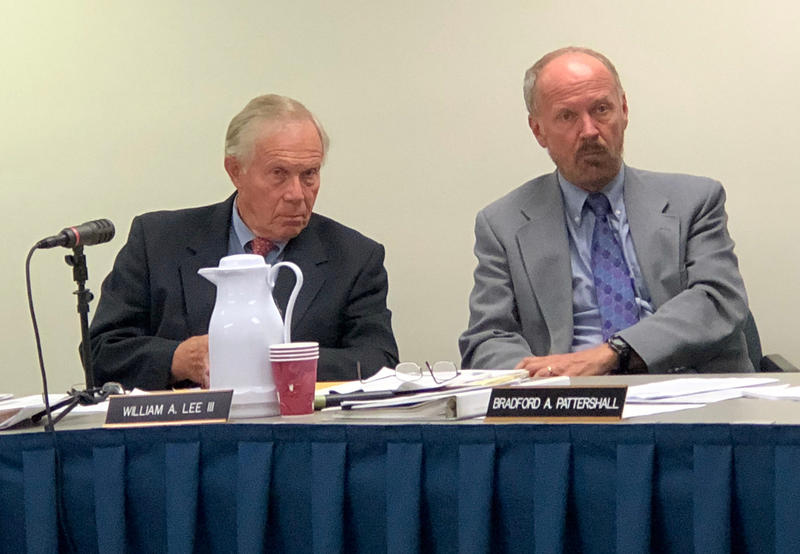 Ethics Commission members Richard Nass and William Lee listen to their legal counsel during a meeting to authorize more money to candidates who qualify for money under Maine's public campaign finance program.