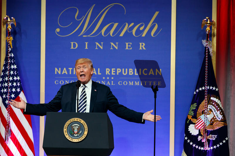 In this March 20, 2018 photo, President Donald Trump speaks to the National Republican Congressional Committee March Dinner at the National Building Museum in Washington.