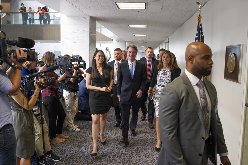 In this Aug. 15, 2018, photo, Supreme Court nominee Brett Kavanaugh, center, walks to the office of Sen. Heidi Heitkamp, D-N.D., for a meeting with her on Capitol Hill in Washington. Kavanaugh is set to meet Tuesday with Sen. Susan Collins of Maine.