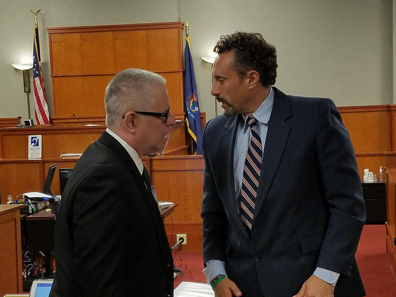 Seth Carey, right, speaks to his attorney, Jim Howaniec, at a court proceeding in August.