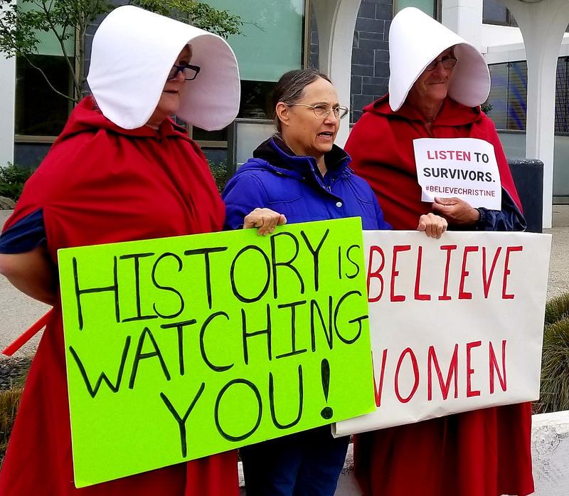 Opponents of Supreme Court nominee Brett Kavanaugh protest at Sen. Susan Collins' Bangor office Thursday.