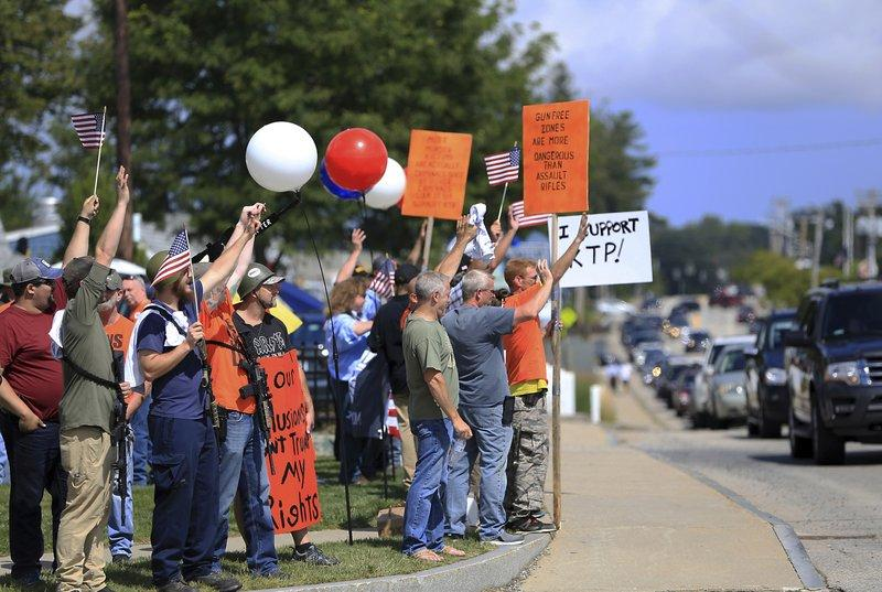 A large group of gun rights advocates gather Saturday, Sept. 1, 2018 to show support for the Kittery Trading Post in Kittery, Maine, as the Resistance Seacoast group held a protest in front of the sporting goods store.