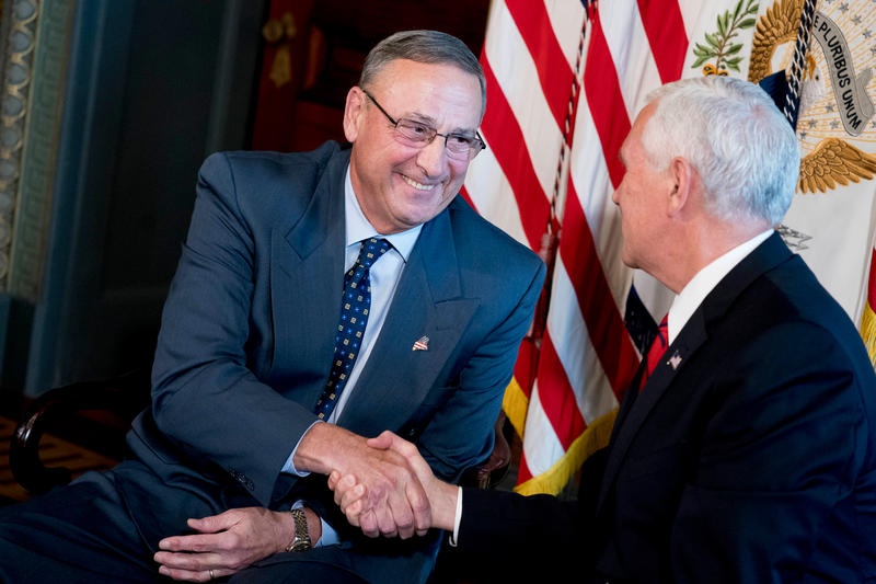 Vice President Mike Pence shakes hands with Maine Gov. Paul LePage (left) in Sept. 2017, in Washington.