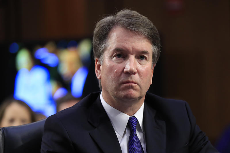 Supreme Court nominee Brett Kavanaugh, listens to Sen. Cory Booker, D-N.J. speak during a Senate Judiciary Committee nominations hearing on Capitol Hill in Washington, Tuesday, Sept. 4, 2018.