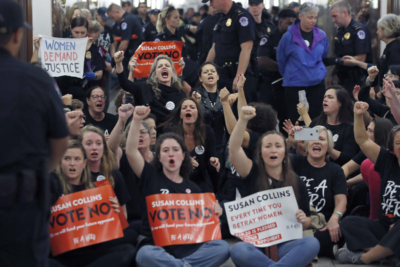 Protesters sit and chant against Judge Brett Kavanaugh as Capitol Hill Police officers make arrests outside the office of Sen. Susan Collins, R-Maine, on Capitol Hill, Monday, Sept. 24, 2018 in Washington.
