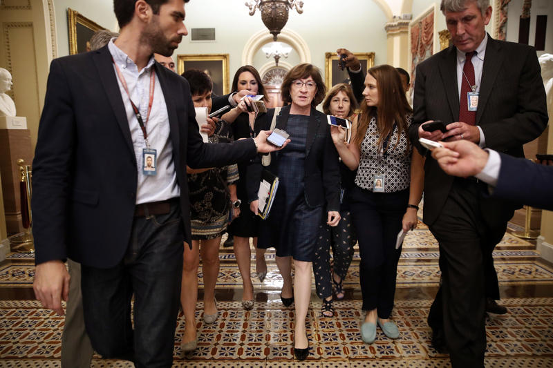 Sen. Susan Collins, R-Maine, is surrounded by reporters asking her questions about Supreme Court nominee Brett Kavanaugh, Wednesday, Sept. 26, 2018, on Capitol Hill in Washington.