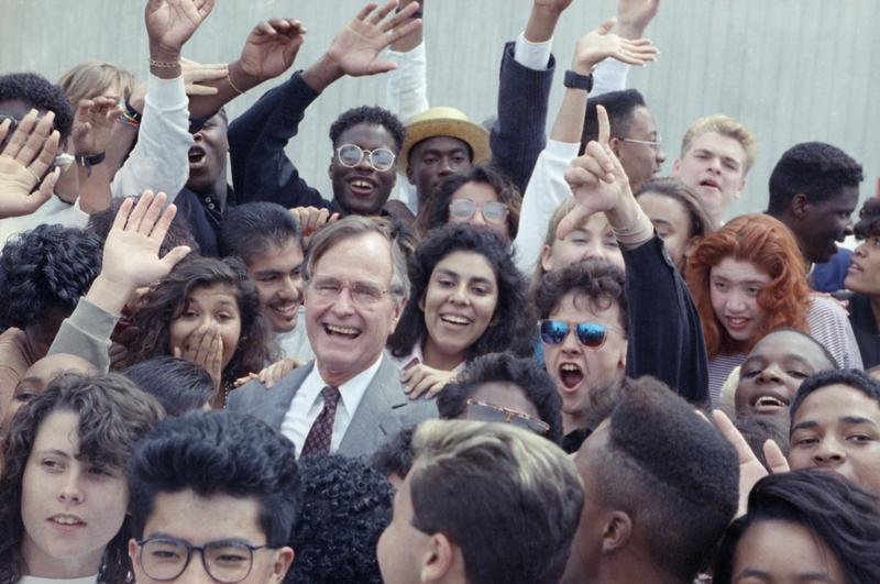 U.S. President George H. Bush is surrounded by cheering students from the Independent Living Program in Los Angeles, Monday, May 21, 1990 as Bush prepared to leave Los Angeles International Airport.