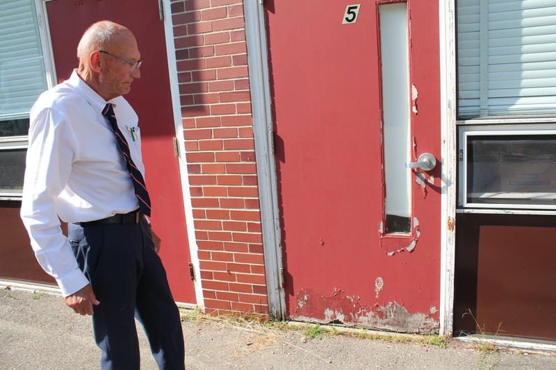 AOS 90 Superintendent Bill Braun points to water damage caused by structural issues at Woodland Elementary School in Baileyville.
