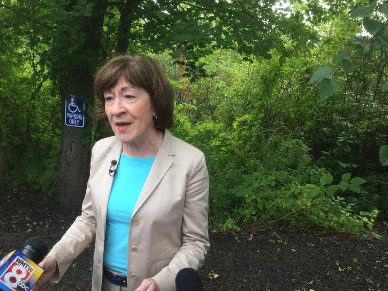 Sen. Susan Collins answers reporters' questions while attending a groundbreaking for a retirement community in Portland Friday.