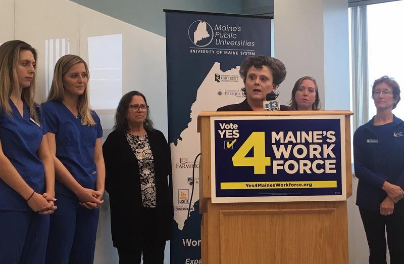 Lisa Harvey McPherson of the Maine Nursing Action Coalition, flanked by USM nursing teachers and students, speaks in support Wednesday of ballot Question 4.