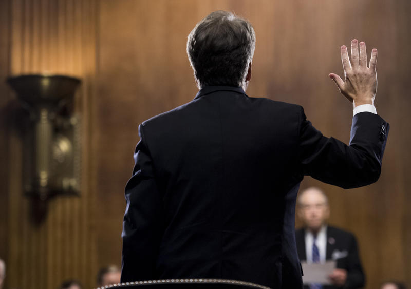 Supreme Court nominee Judge Brett Kavanaugh is sworn in by Chairman Chuck Grassley, R-Iowa, before testifying during the Senate Judiciary Committee, Thursday, Sept. 27, 2018 on Capitol Hill in Washington.