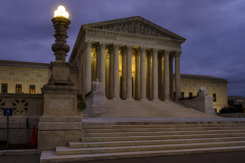 The U. S. Supreme Court building stands quietly before dawn in Washington, Friday, Oct. 5, 2018.