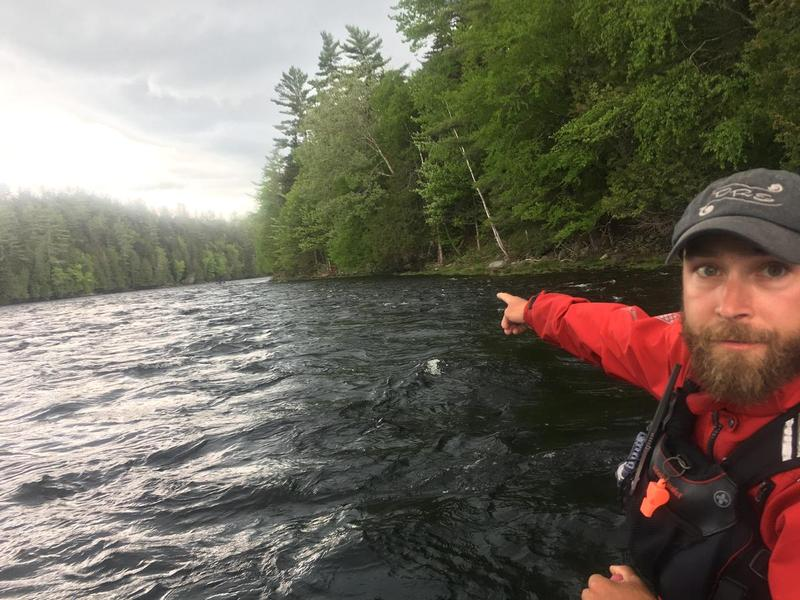 Kevin Ross, a rafting guide for Dead River Expeditions, points to a section of the Kennebec River Gorge where CMP proposes a major transmission line crossing. It would arc over an otherwise undeveloped seven mile stretch of the river.