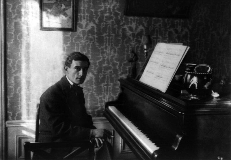 Maurice Ravel at a piano in 1912