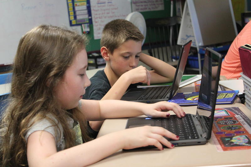 Students Kaylee Bodge and William Cooper practice independent math problems at Marcia Buker Elementary School in Richmond, Maine.