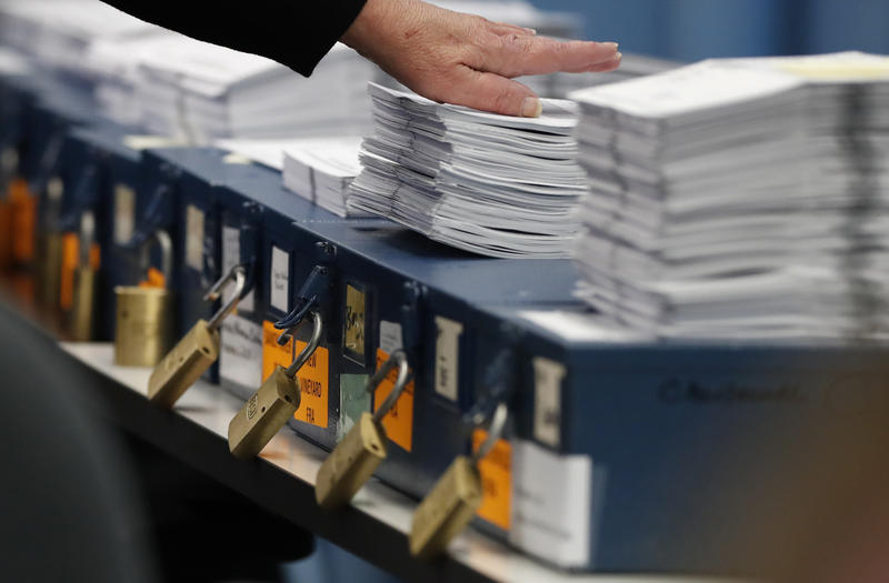 Ballots are prepared to be tabulated for Maine's Second Congressional District's House election Monday, Nov. 12, 2018, in Augusta, Maine.