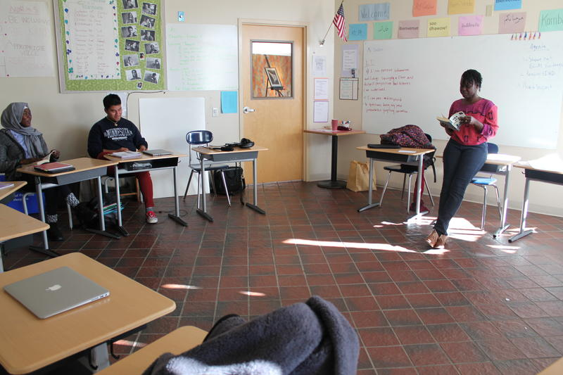 Teacher Sarai Manyiel works with students inside her classroom at Portland's Casco Bay High School.