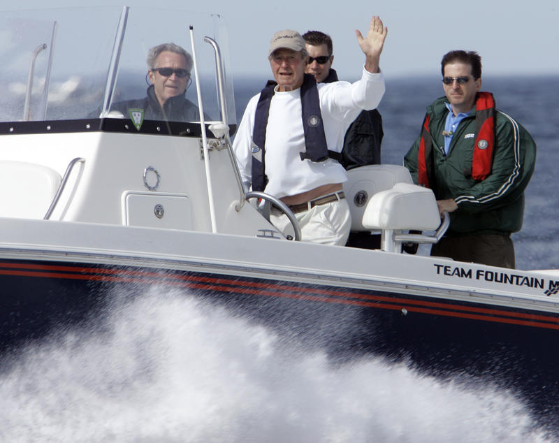 President Bush, front left, rides with his father, former President George H. W. Bush waving from his speedboat, Fidelity III, as they head back to Walker's Point after fishing Thursday, Aug. 9, 2007, off Kennebunkport, Maine.