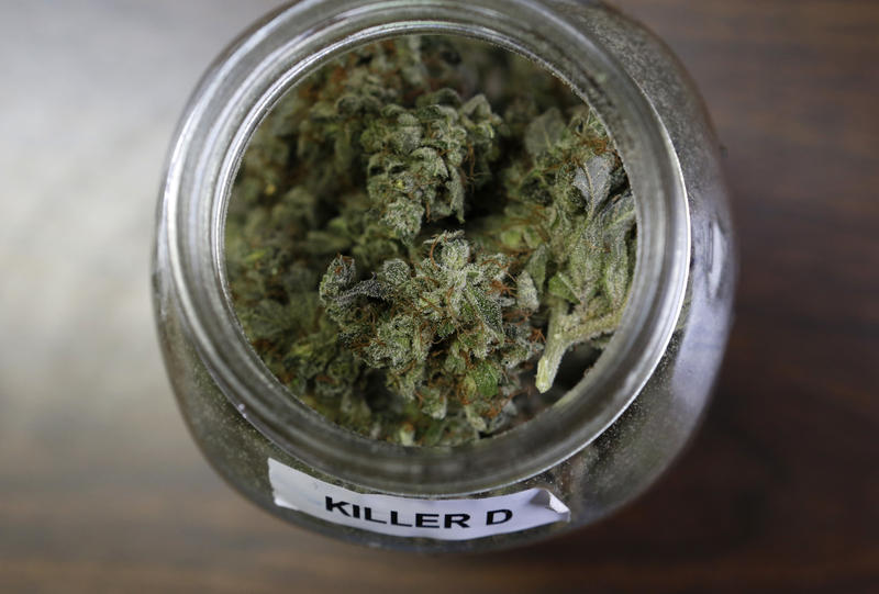 "In this Friday, April 22, 2016 photo, a jar containing a strain of marijuana nicknamed ""Killer D"" is seen at a medical marijuana facility in Unity, Maine."