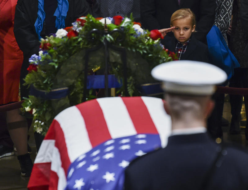 Stephen G. Leighton Jr. salutes as he pays his respects to former President George H.W. Bush in the Capitol's Rotunda in Washington, Monday, Dec. 3, 2018